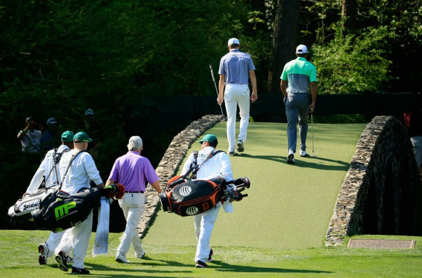AUGUSTA, GA - APRIL 08: Tiger Woods of the United States, Ben Crenshaw of the United States and Jordan Spieth of the United States walk over the Hogan Bridge with their caddies during a practice round prior to the start of the 2015 Masters Tournament at Augusta National Golf Club on April 8, 2015 in Augusta, Georgia. (Photo by Jamie Squire/Getty Images)