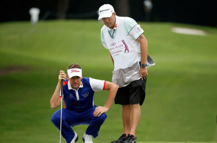 FORT WORTH, TX - MAY 23: Ian Poulter of England waits on the 12th green with his caddie Terry Mundy during the third round of the Crowne Plaza Invitational at the Colonial Country Club on May 23, 2015 in Fort Worth, Texas. (Photo by Scott Halleran/Getty Images)