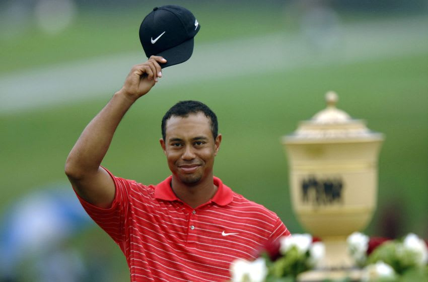 AKRON, OH - AUGUST 27: Tiger Woods acknowledges the crowd after winning the Bridgestone Invitational at Firestone Country Club August 27, 2006 in Akron, Ohio. (Photo by Montana Pritchard/Getty Images)