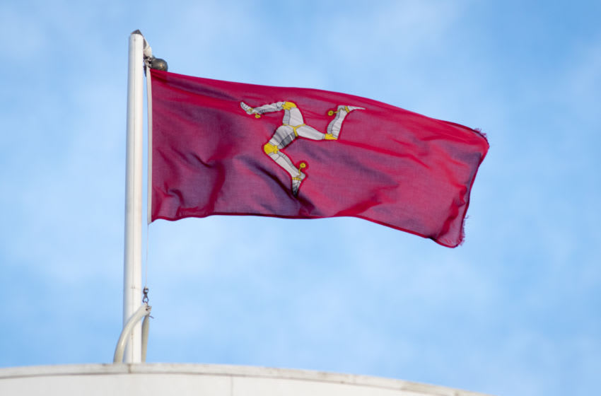 DOUGLAS, ISLE OF MAN - NOVEMBER 09: The 'Legs of Man' flag is pictured on November 9, 2017 in Douglas, Isle of Man. The Isle of Man is a low-tax British Crown Dependency with a population of just 85 thousand in the Irish Sea off the west coast England. Recent revelations in the Paradise Papers have linked the island to tax loopholes being used by Apple and Nike, as well as celebrities such as Formula One champion Lewis Hamilton. (Photo by Matt Cardy/Getty Images)