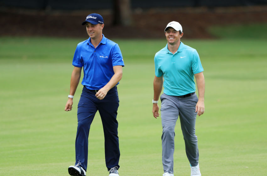 ATLANTA, GEORGIA - AUGUST 23: Justin Thomas of the United States and Rory McIlroy of Northern Ireland walk on the 12th hole during the second round of the TOUR Championship at East Lake Golf Club on August 23, 2019 in Atlanta, Georgia. (Photo by Sam Greenwood/Getty Images)