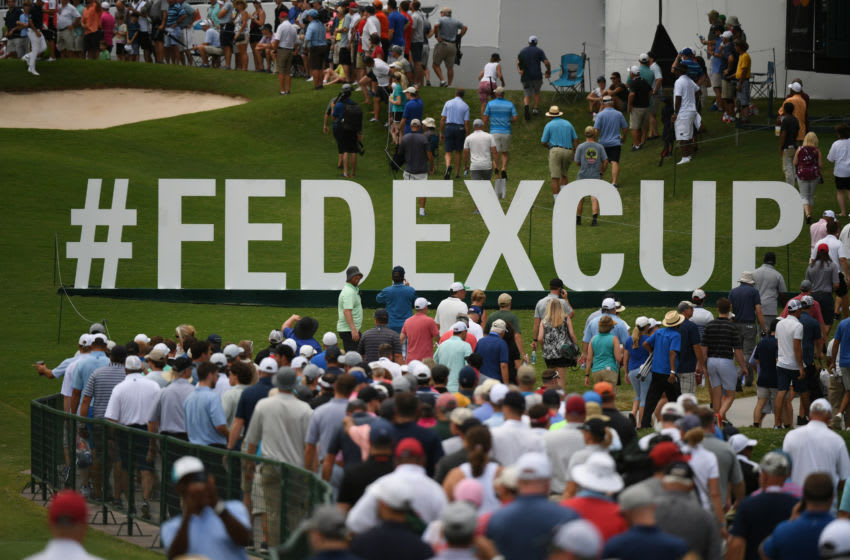 Aug 23, 2019; Atlanta, GA, USA; Patrons walk by FedEx Cup signage during the second round of the Tour Championship golf tournament at East Lake Golf Club. Mandatory Credit: Adam Hagy-USA TODAY Sports