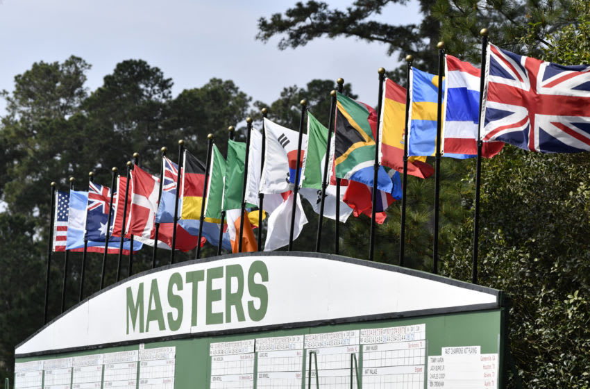 Apr 8, 2019; Augusta, GA, USA; The main Masters scoreboard with flags from all the nations represented in the tournament during a practice round for the Masters golf tournament at Augusta National Golf Club. Mandatory Credit: Michael Madrid-USA TODAY Sports