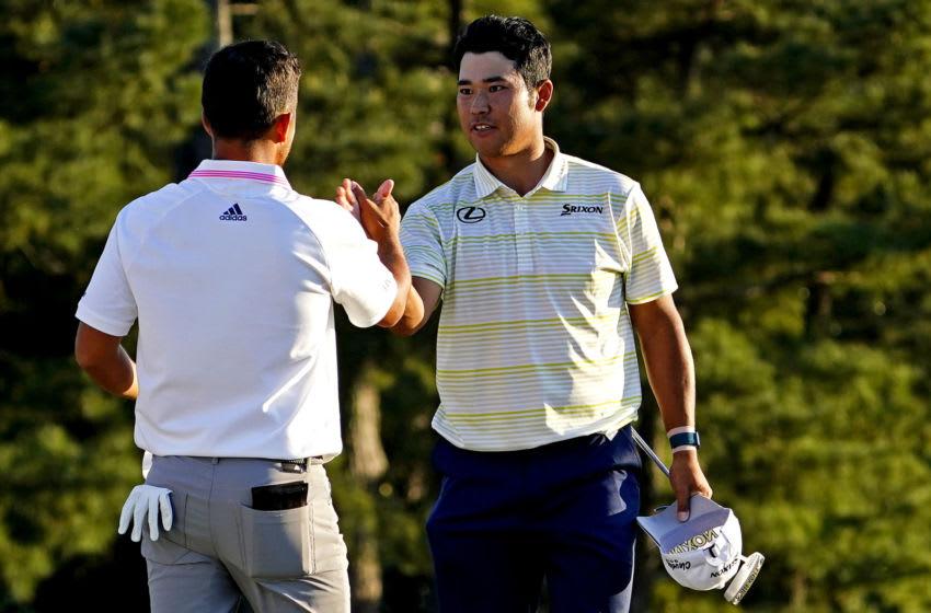 Apr 11, 2021; Augusta, Georgia, USA; Hideki Matsuyama greets Xander Schauffele after winning The Masters golf tournament. Mandatory Credit: Michael Madrid-USA TODAY Sports