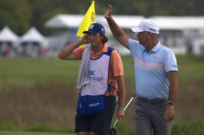 Apr 18, 2021; Hilton Head, South Carolina, USA; Stewart Cink celebrates with his caddie on the green of the eighteenth hole after winning the 2021 RBC Heritage golf tournament. Mandatory Credit: Joshua S. Kelly-USA TODAY Sports