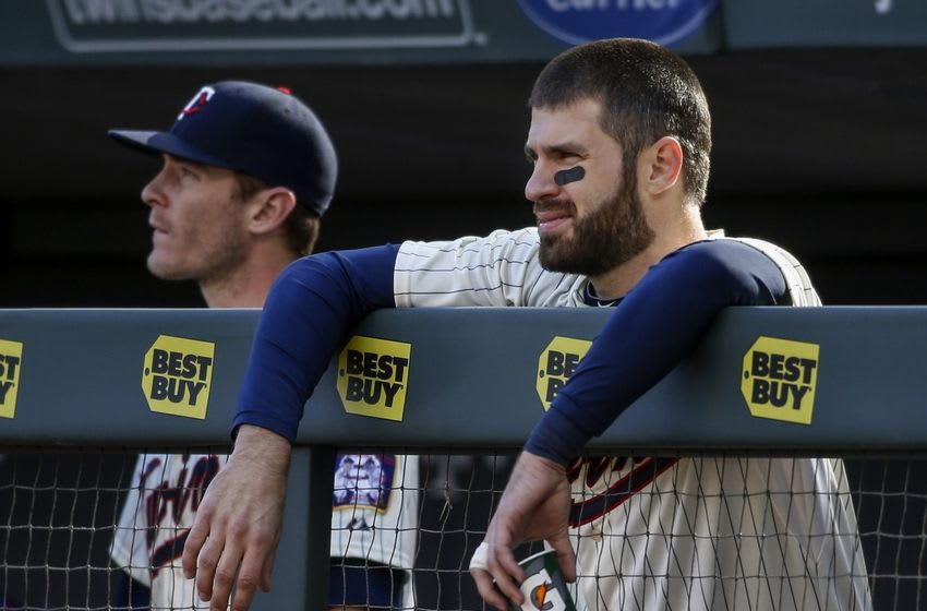 Oct 3, 2015; Minneapolis, MN, USA; Minnesota Twins first baseman Joe Mauer (7) watches as his team struggles against the Kansas City Royals in the ninth inning at Target Field. The Royals win 5-1. The Twins loss eliminated them from the playoffs. Mandatory Credit: Bruce Kluckhohn-USA TODAY Sports