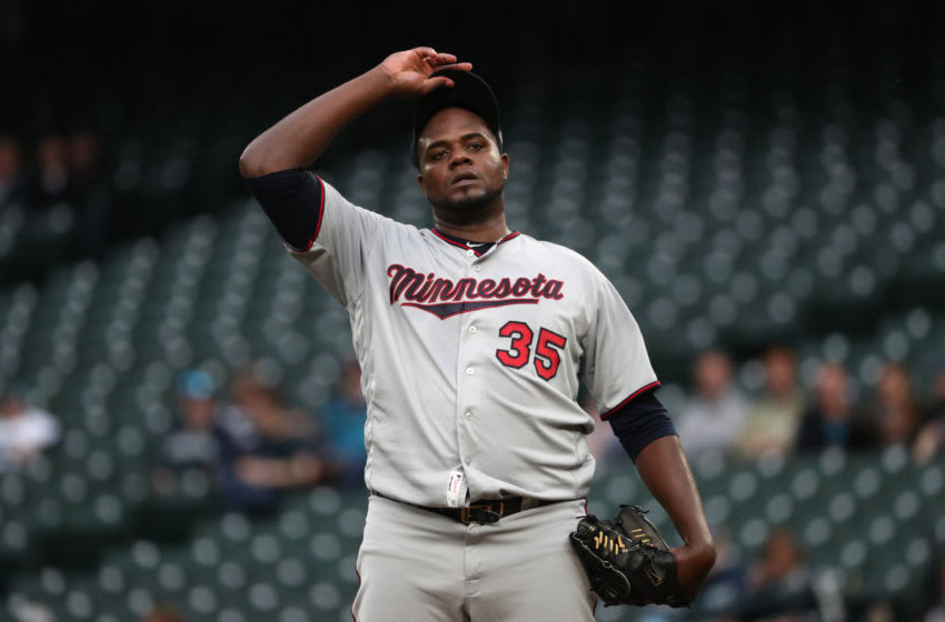 SEATTLE, WASHINGTON - MAY 16: Michael Pineda #35 of the Minnesota Twins reacts after giving up a hit to Mitch Haniger of the Seattle Mariners in the first inning during their game at T-Mobile Park on May 16, 2019 in Seattle, Washington. (Photo by Abbie Parr/Getty Images)