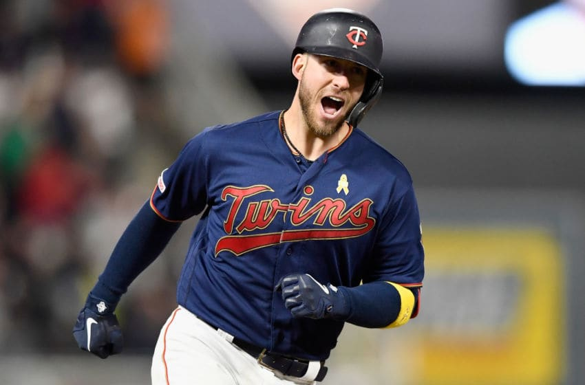 MINNEAPOLIS, MINNESOTA - SEPTEMBER 07: Mitch Garver #18 of the Minnesota Twins celebrates as he rounds the bases after hitting a three-run home run against the Cleveland Indians during the seventh inning of the game at Target Field on September 7, 2019 in Minneapolis, Minnesota. (Photo by Hannah Foslien/Getty Images)