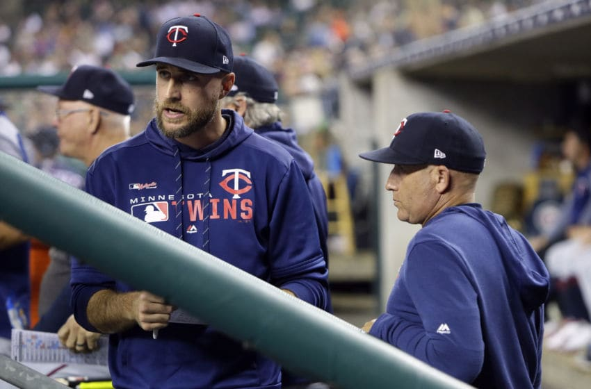 Manager Rocco Baldelli of the Minnesota Twins talks with pitching coach Wes Johnson of the Minnesota Twins (Photo by Duane Burleson/Getty Images)