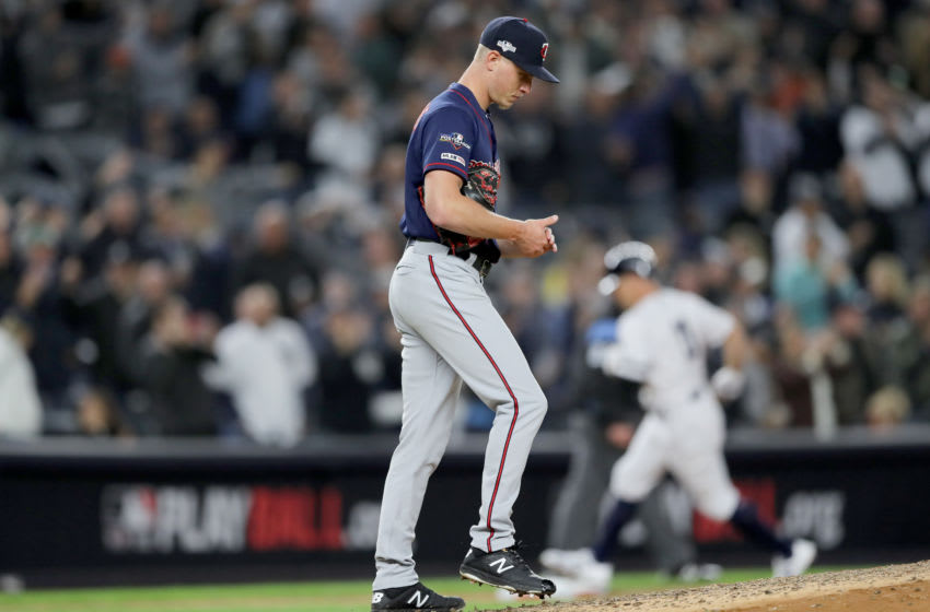 NEW YORK, NEW YORK - OCTOBER 04: Cody Stashak #61 of the Minnesota Twins reacts after giving up a home run hit by Brett Gardner #11 of the New York Yankees during the sixth inning in game one of the American League Division Series at Yankee Stadium on October 04, 2019 in New York City. (Photo by Elsa/Getty Images)