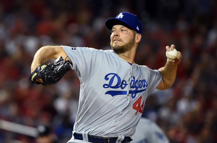 WASHINGTON, DC - OCTOBER 07: Rich Hill #44 of the Los Angeles Dodgers delivers in the first inning against the Washington Nationals in game four of the National League Division Series at Nationals Park on October 07, 2019 in Washington, DC. (Photo by Will Newton/Getty Images)