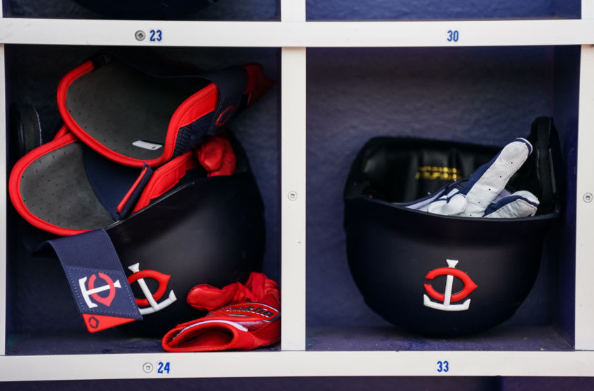 Minnesota Twins helmets in the dugout during a spring training game (Photo by Brace Hemmelgarn/Minnesota Twins/Getty Images)