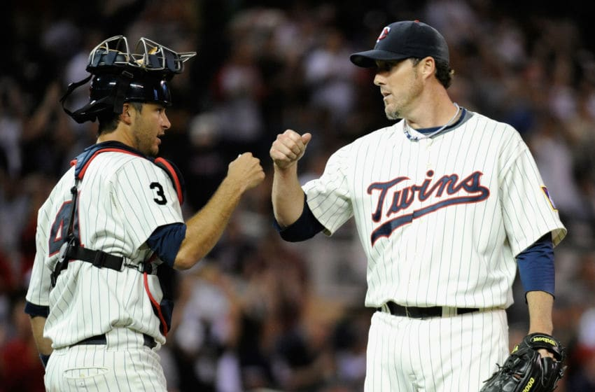 Drew Butera and Joe Nathan of the Minnesota Twins (Photo by Hannah Foslien/Getty Images)