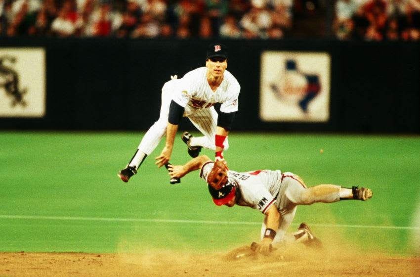 MINNEAPOLIS, MN - OCTOBER 26: Greg Gagne of the Minnesota Twins turns a double play during World Series game six between the Atlanta Braves and Minnesota Twins on October 26, 1991 at the Hubert H. Humphrey Metrodome in Minneapolis, Minnesota. The Twins defeated the Braves 4-3. (Photo by Rich Pilling/Getty Images)