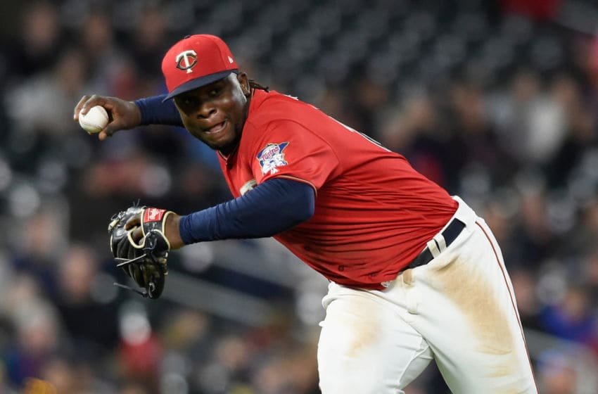 MINNEAPOLIS, MN - APRIL 21: Miguel Sano #22 of the Minnesota Twins throws to first base to get out Justin Upton #8 of the Detroit Tigers during the eighth inning of the game on April 21, 2017 at Target Field in Minneapolis, Minnesota. The Twins defeated the Tiger 6-3. (Photo by Hannah Foslien/Getty Images)
