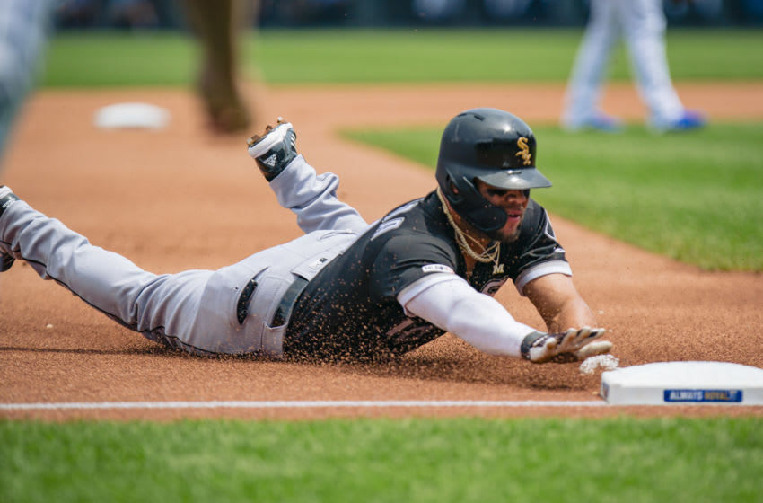 Yoan Moncada of the Chicago White Sox slides into third, beating the tag. (Photo by Kyle Rivas/Getty Images)