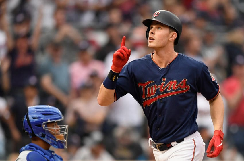 MINNEAPOLIS, MN - JUNE 15: Max Kepler #26 of the Minnesota Twins celebrates as he crosses home plate after hitting a solo home run as Brad Boxberger #26 of the Kansas City Royals looks on during the fourth inning of the game on June 15, 2019 at Target Field in Minneapolis, Minnesota. The Twins defeated the Royals 5-4. (Photo by Hannah Foslien/Getty Images)
