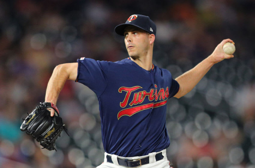 MINNEAPOLIS, MINNESOTA - JUNE 26: Taylor Rogers #55 of the Minnesota Twins pitches in the eighth inning against the Tampa Bay Rays at Target Field on June 26, 2019 in Minneapolis, Minnesota. The Minnesota Twins defeated the Tampa Bay Rays 6-4.(Photo by Adam Bettcher/Getty Images)