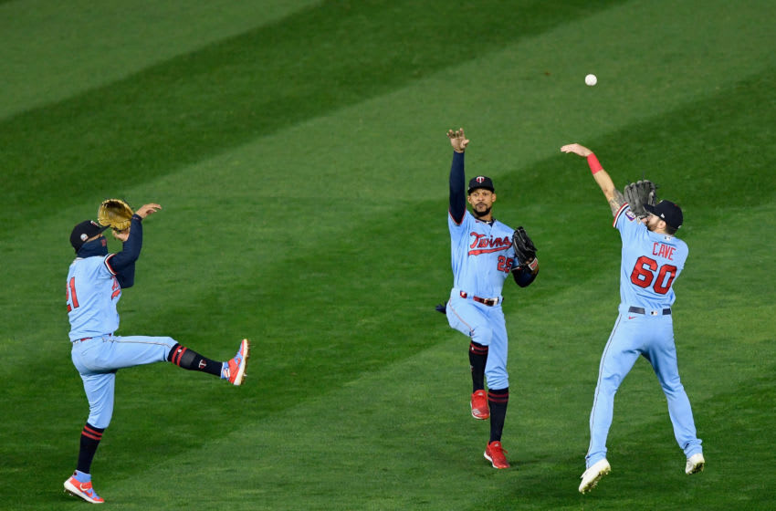 Eddie Rosario, Byron Buxton, and Jake Cave of the Minnesota Twins celebrate defeating the Cleveland Indians. (Photo by Hannah Foslien/Getty Images)