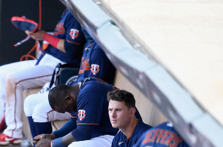 Miguel Sano and Max Kepler of the Minnesota Twins sit in the dugout after being defeated by the Houston Astros in Game Two. (Photo by Hannah Foslien/Getty Images)
