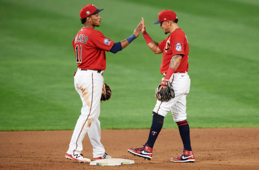 Jorge Polanco and Ildemaro Vargas of the Minnesota Twins celebrate defeating the Milwaukee Brewers. (Photo by Hannah Foslien/Getty Images)