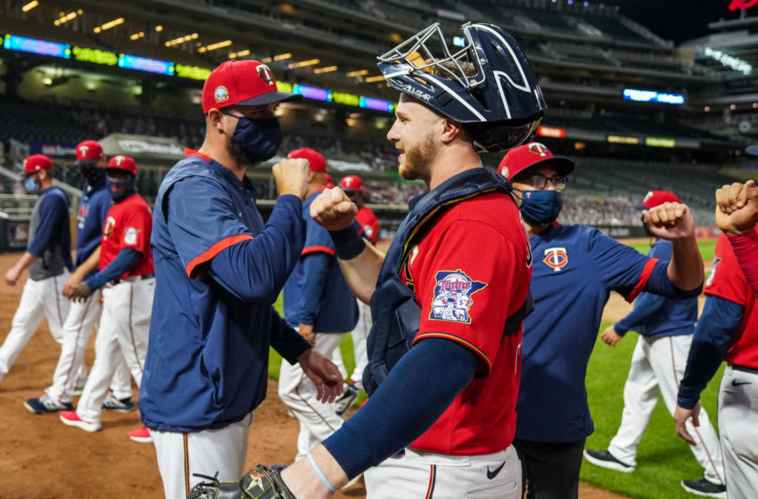 Manager Rocco Baldelli of the Minnesota Twins celebrates with Ryan Jeffers against the Milwaukee Brewers. (Photo by Brace Hemmelgarn/Minnesota Twins/Getty Images)