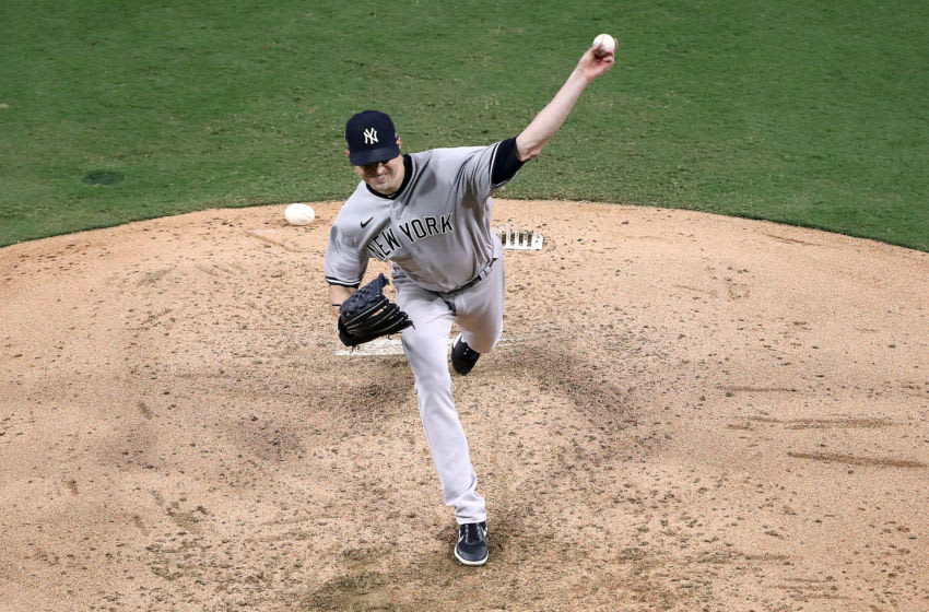 J.A. Happ of the New York Yankees delivers the pitch against the Tampa Bay Rays. (Photo by Sean M. Haffey/Getty Images)