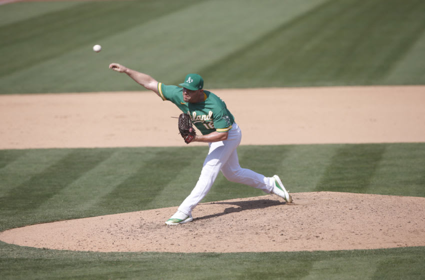 Liam Hendriks of the Oakland Athletics pitches during the game against the Chicago White Sox. (Photo by Michael Zagaris/Oakland Athletics/Getty Images)