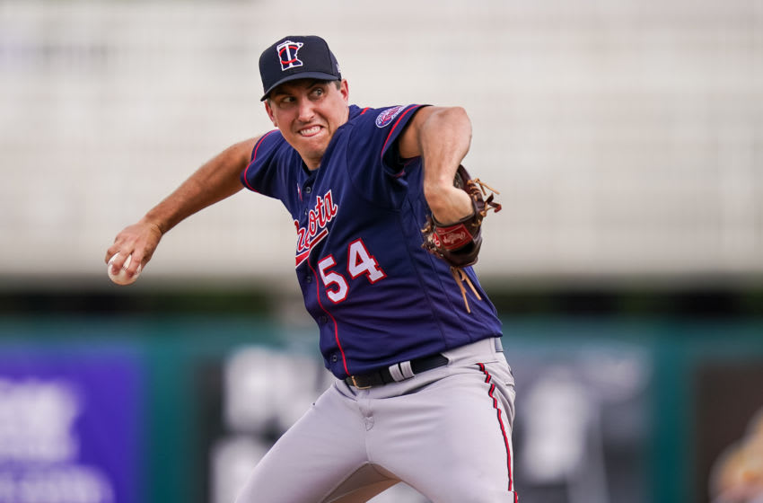 Derek Law of the Minnesota Twins pitches during a team workout on at the Hammond Stadium in Fort Myers, Florida.