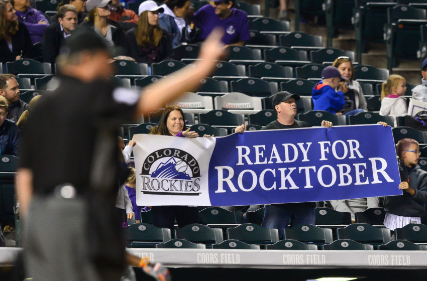 DENVER, CO - SEPTEMBER 16: Colorado Rockies fans hold a sign referring to