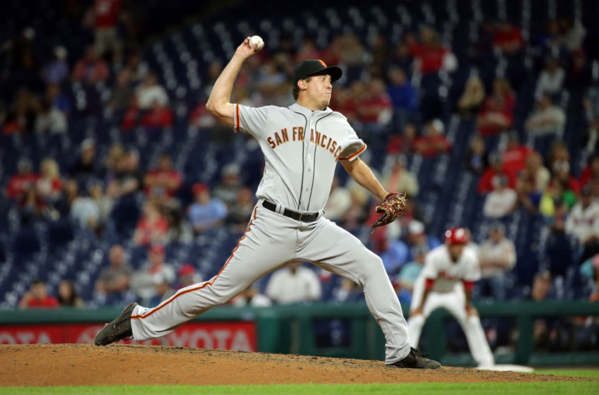 Derek Law of the San Francisco Giants throws a pitch during a game against the Philadelphia Phillies. (Photo by Hunter Martin/Getty Images)
