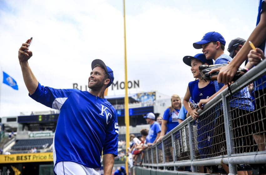 KANSAS CITY, MO - JUNE 02: Jason Adam #50 of the Kansas City Royals takes a selfie with some young fans before the game against the Oakland Athletics at Kauffman Stadium on June 2, 2018 in Kansas City, Missouri. (Photo by Brian Davidson/Getty Images)