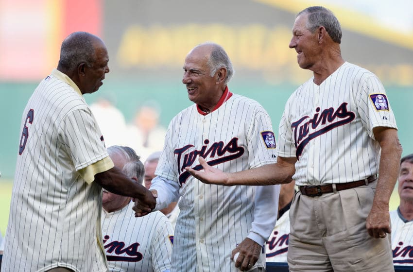 Tony Oliva, former player with the Minnesota Twins, shakes hands with former teammates Frank Quilici and Jim Kaat during a ceremony honoring the 1965 American League Championship team (Photo by Hannah Foslien/Getty Images)
