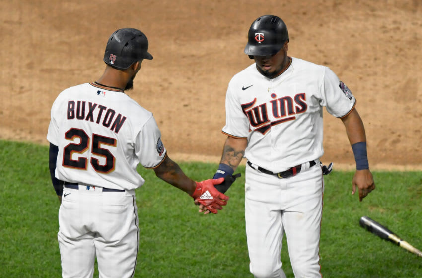 Byron Buxton of the Minnesota Twins congratulates teammate Luis Arraez on scoring a run. (Photo by Hannah Foslien/Getty Images)