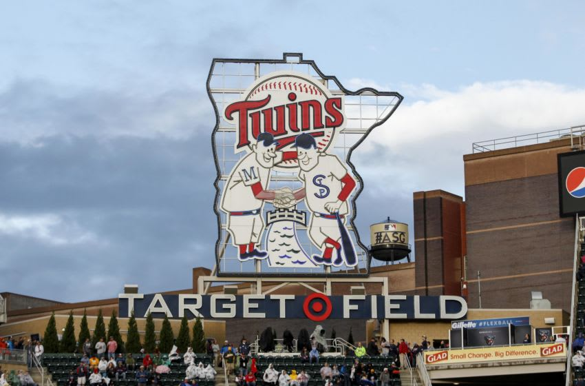 The Target Field sign stands in front of a water tower with the All-Star Game logo on it. (Photo by Bruce Kluckhohn/Minnesota Twins/Getty Images)