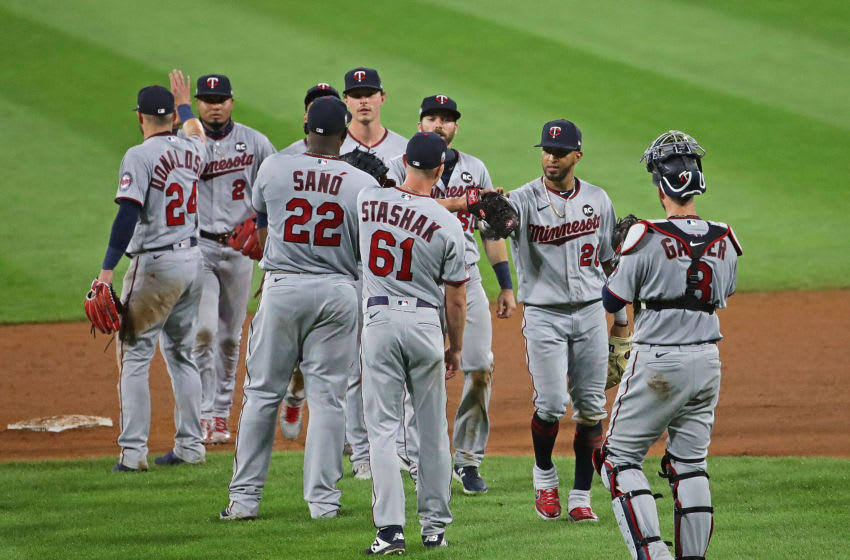 Members of the Minnesota Twins celebrate a win over the Chicago White Sox during the Opening Day game at Guaranteed Rate Field on July 24, 2020. The Twins defeated the White Sox 10-5. (Photo by Jonathan Daniel/Getty Images)