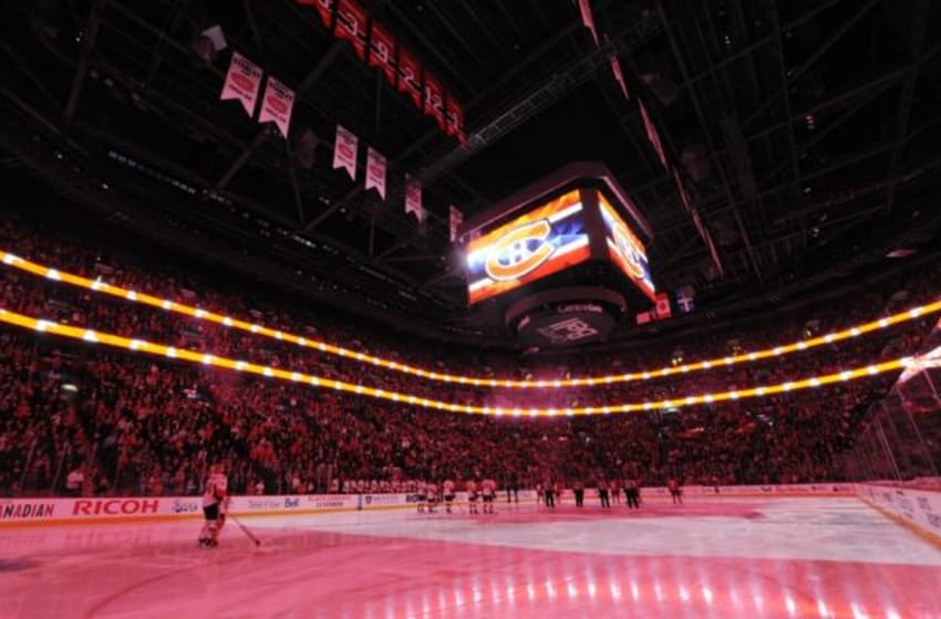 Nov 3, 2015; Montreal, Quebec, CAN; Players listen to the National Anthem before the game between the Ottawa Senators and the Montreal Canadiens at the Bell Centre. Mandatory Credit: Eric Bolte-USA TODAY Sports