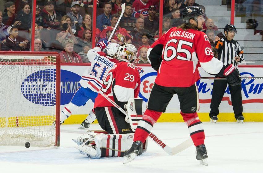Oct 3, 2015; Ottawa, Ontario, CAN; Montreal Canadiens center David Desharnais (51) scores on Ottawa Senators goalie Matt O'Connor (29) in the first period at Canadian Tire Centre. Mandatory Credit: Marc DesRosiers-USA TODAY Sports