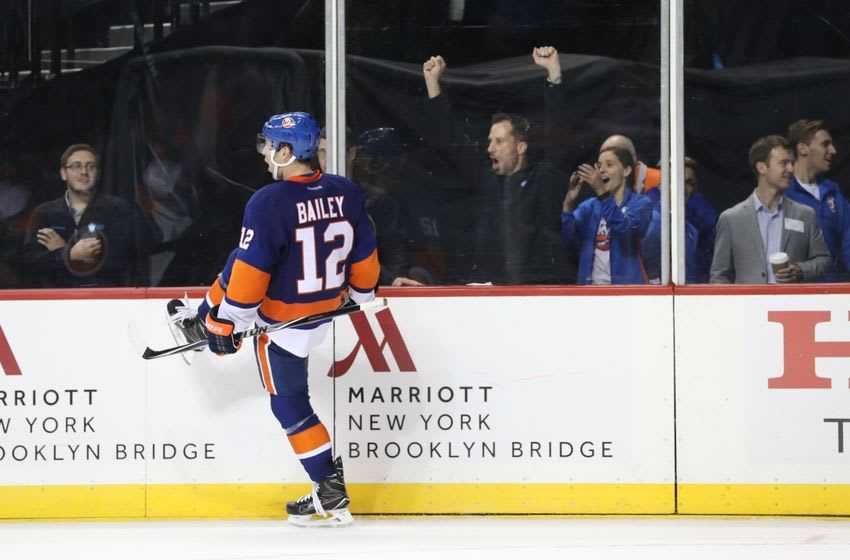 Oct 16, 2016; Brooklyn, NY, USA; New York Islanders right wing Josh Bailey (12) celebrates scoring the game winning goal in overtime against the Anaheim Ducks at Barclays Center. New York Islanders won 3-2 in overtime. Mandatory Credit: Anthony Gruppuso-USA TODAY Sports