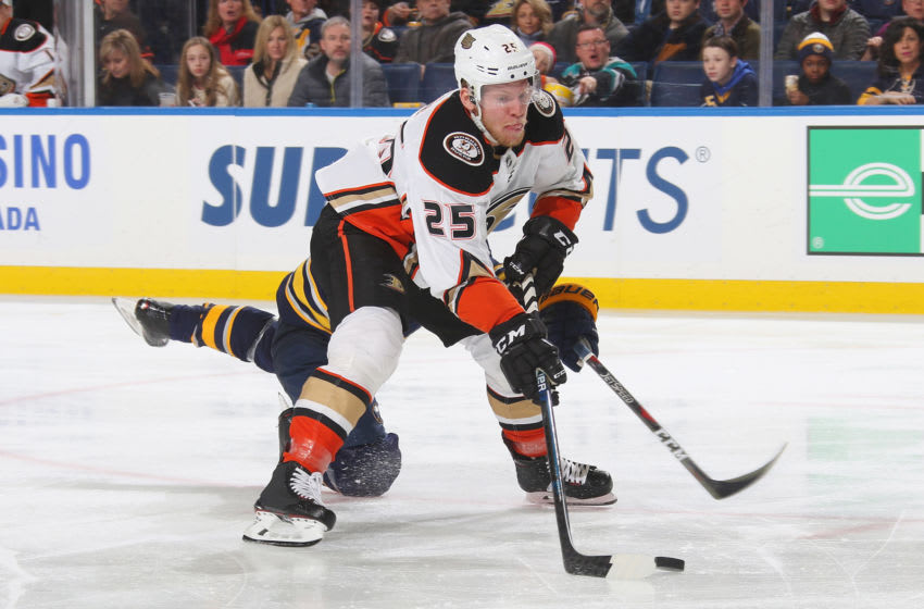 BUFFALO, NY - DECEMBER 22: Ondrej Kase #25 of the Anaheim Ducks controls the puck against Lawrence Pilut #24 of the Buffalo Sabres during an NHL game on December 22, 2018 at KeyBank Center in Buffalo, New York. (Photo by Rob Marczynski/NHLI via Getty Images)