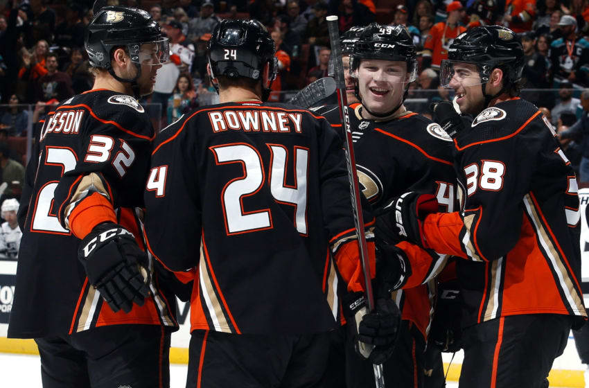 ANAHEIM, CA - APRIL 5: Max Jones #49, Carter Rowney #24, Jacob Larsson #32, and Derek Grant #38 of the Anaheim Ducks celebrate Rowney's first period goal during the game against the Los Angeles Kings on April 5, 2019 at Honda Center in Anaheim, California. (Photo by Debora Robinson/NHLI via Getty Images)