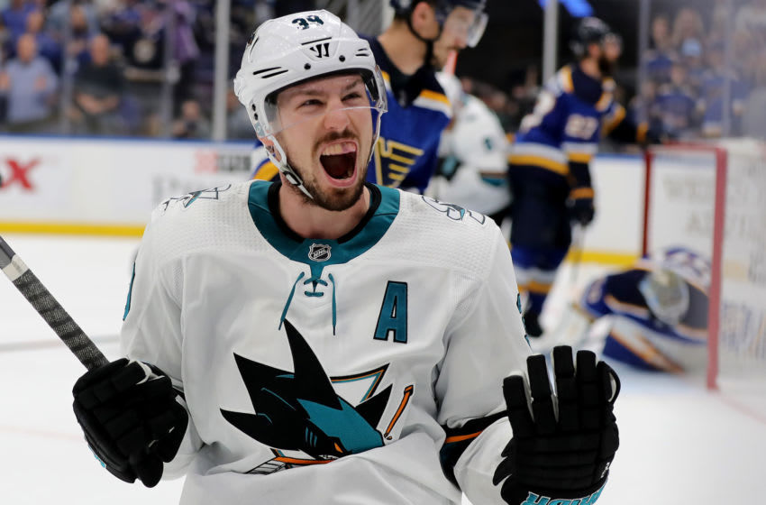 ST LOUIS, MISSOURI - MAY 15: Logan Couture #39 of the San Jose Sharks celebrates after scoring a goal on Jordan Binnington #50 of the St. Louis Blues during the third period in Game Three of the Western Conference Finals during the 2019 NHL Stanley Cup Playoffs at Enterprise Center on May 15, 2019 in St Louis, Missouri. (Photo by Elsa/Getty Images)