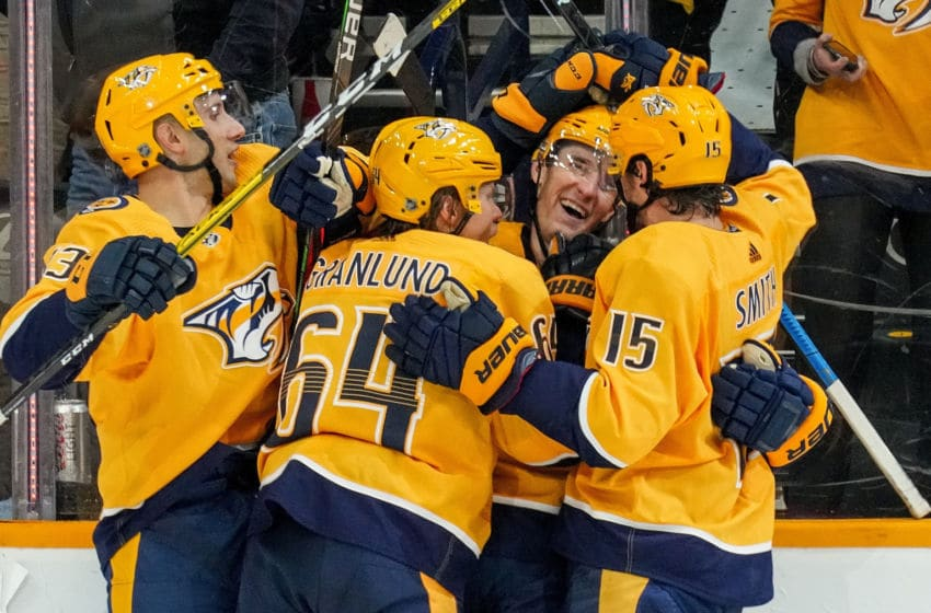NASHVILLE, TN - OCTOBER 19: Kyle Turris #8 celebrates his game tying goal with Craig Smith #15, Mikael Granlund #64 and Nick Bonino #13 of the Nashville Predators against the Florida Panthers at Bridgestone Arena on October 19, 2019 in Nashville, Tennessee. (Photo by John Russell/NHLI via Getty Images)