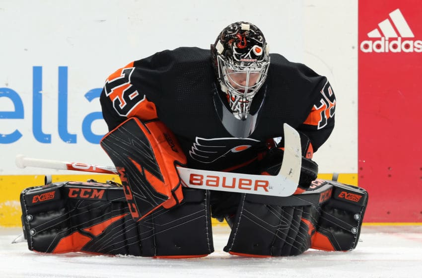 PHILADELPHIA, PA - OCTOBER 19: Carter Hart #79 of the Philadelphia Flyers warms up against the Dallas Stars on October 19, 2019 at the Wells Fargo Center in Philadelphia, Pennsylvania. (Photo by Len Redkoles/NHLI via Getty Images)