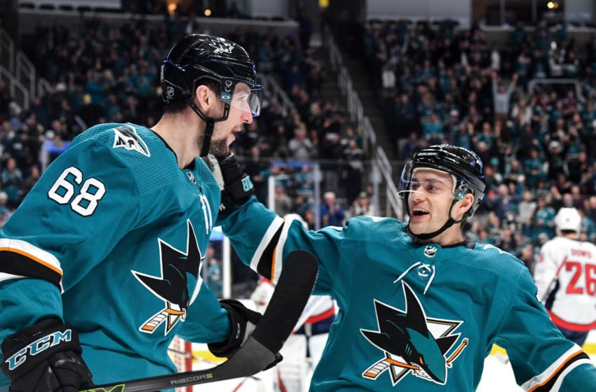 SAN JOSE, CA - DECEMBER 3: Melker Karlsson #68 and Dylan Gambrell #7 of the San Jose Sharks celebrate scoring a goal against the Washington Capitals at SAP Center on December 3, 2019 in San Jose, California. (Photo by Brandon Magnus/NHLI via Getty Images)