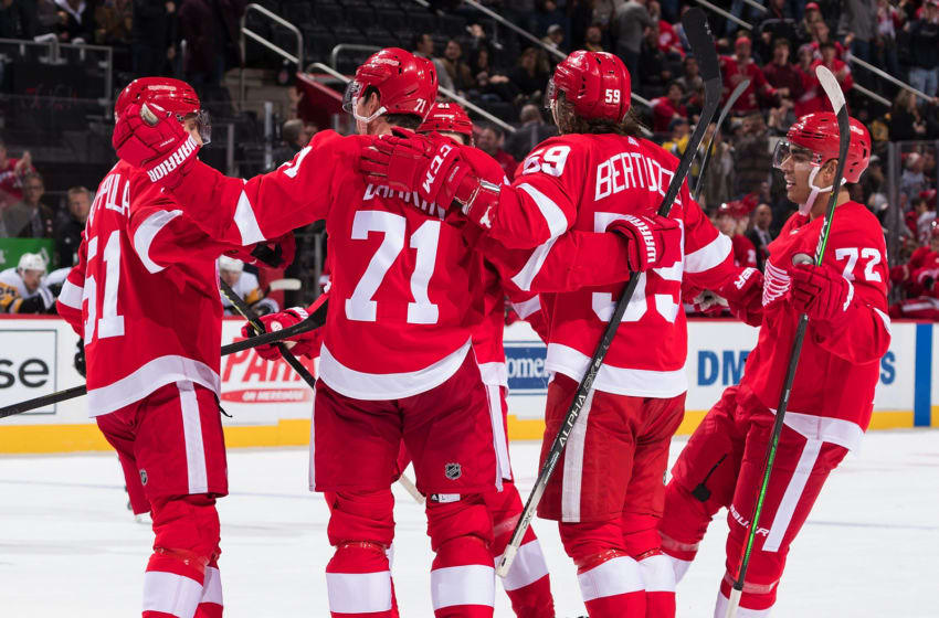 DETROIT, MI - DECEMBER 07: Dylan Larkin #71 of the Detroit Red Wings celebrates his third period goal with teammates Valtteri Filppula #51, Tyler Bertuzzi #59 and Andreas Athanasiou #72 during an NHL game against the Pittsburgh Penguins at Little Caesars Arena on December 7, 2019 in Detroit, Michigan. The Penguins defeated the Wings 5-3. (Photo by Dave Reginek/NHLI via Getty Images)