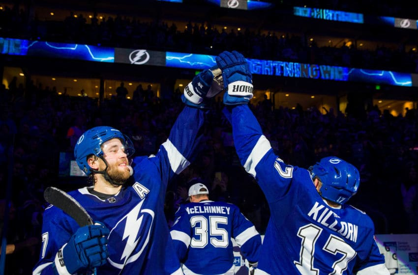 TAMPA, FL - JANUARY 7: Victor Hedman #77 and Alex Killorn #17 of the Tampa Bay Lightning celebrate the win against the Vancouver Canucks at Amalie Arena on January 7, 2020 in Tampa, Florida (Photo by Scott Audette/NHLI via Getty Images)