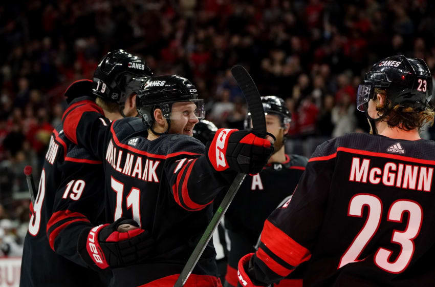 RALEIGH, NC - JANUARY 10: Lucas Wallmark #71 of the Carolina Hurricanes celebrates with teammates after scoring a goal during an NHL game against the Arizona Coyotes on January 10, 2020 at PNC Arena in Raleigh, North Carolina. (Photo by Gregg Forwerck/NHLI via Getty Images)