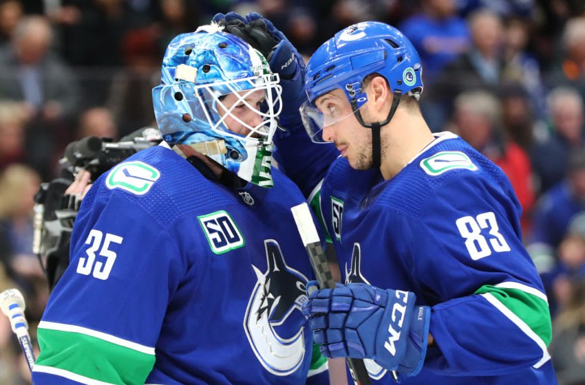 VANCOUVER, BC - JANUARY 27: Vancouver Canucks Goalie Thatcher Demko (35) is congratualted by teammate Center Jay Beagle (83) after defeating the St. Louis Blues 3-1 during their NHL game at Rogers Arena on January 27, 2020 in Vancouver, British Columbia, Canada. (Photo by Devin Manky/Icon Sportswire via Getty Images)