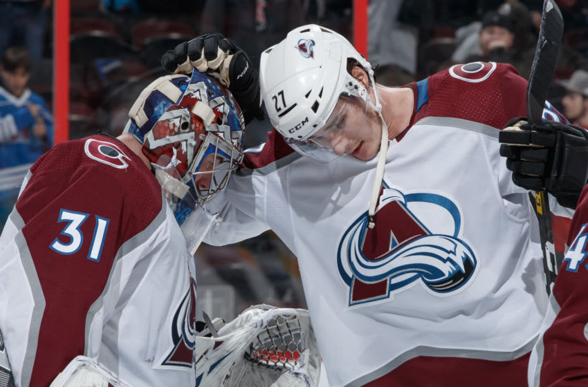 OTTAWA, ON - FEBRUARY 6: Philipp Grubauer #31 and Ryan Graves #27 of the Colorado Avalanche celebrate their 4-1 win over the Ottawa Senators at Canadian Tire Centre on February 6, 2020 in Ottawa, Ontario, Canada. (Photo by Andre Ringuette/NHLI via Getty Images)
